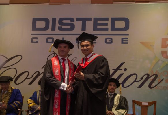 CHAYAKORN SUWANNACHOT from Thailand receiving his award in BA (hons) International Business Management from Prof Dr Ieuan Ellis, Pro Vice Chancellor of Staffordshire University, UK.