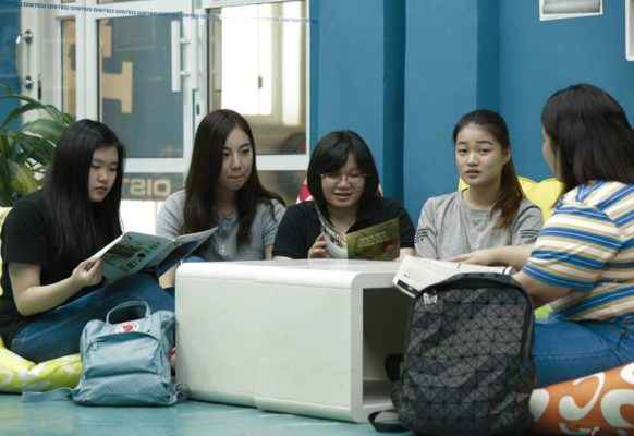 International students enjoy some light reading at DISTED Library